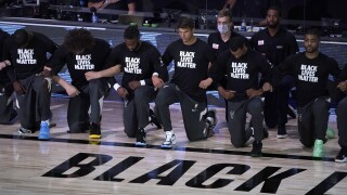 Milwaukee Bucks, Boston Celtics kneel during national anthem before resuming season