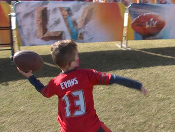 kid throws football.png