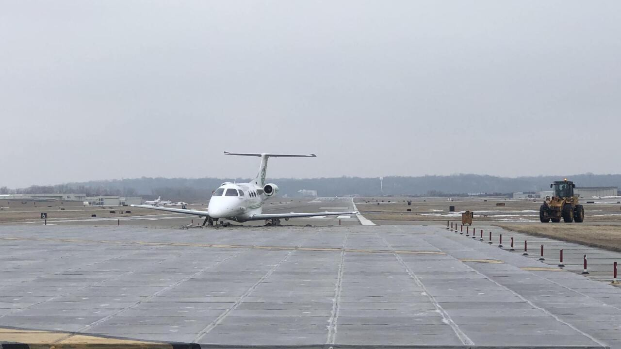 Plane Slides Off Downtown Runway During Icy Conditions