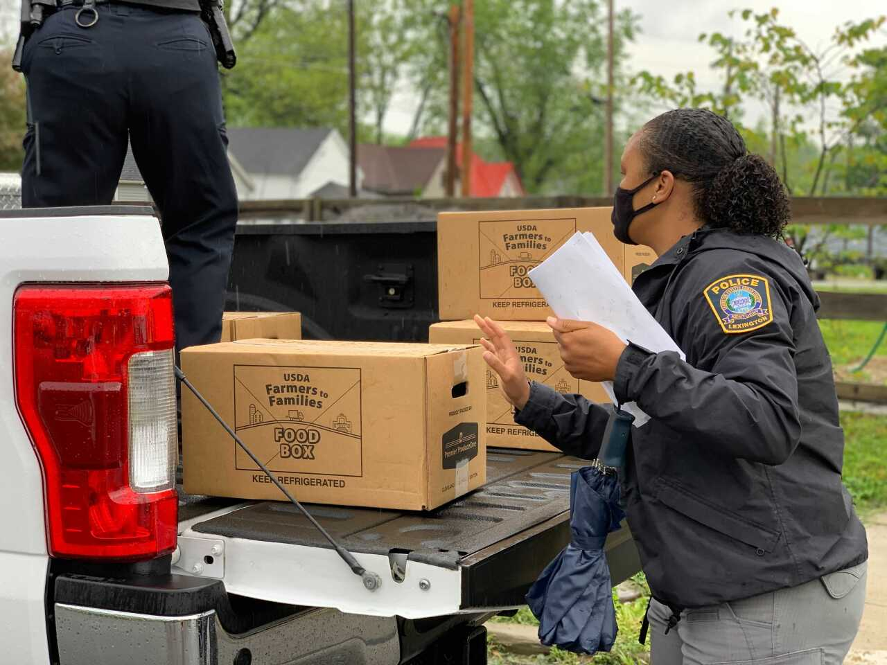 Police woman loading boxes.jpg