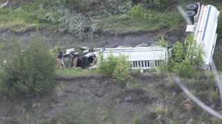 Truck crashes through guardrail, slides toward river in Great Falls