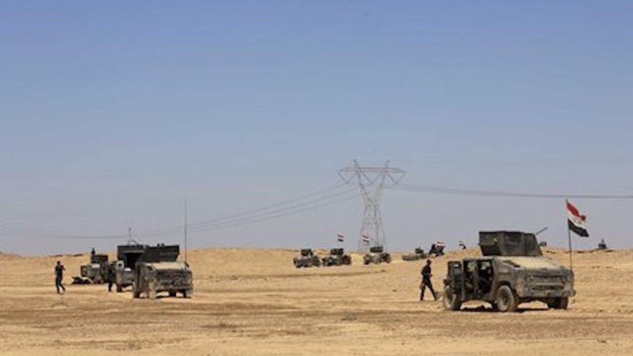 Iraqi forces face ISIS resistance in Hit