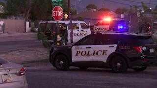 Tucson Police respond to an officer-involved shooting after two other shootings in the neighborhood near Silverlake Park Sunday.