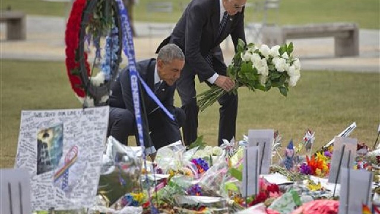 Obama embraces Orlando families, appeals for gun controls