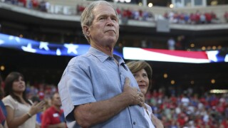 President George W. Bush asks 'How do we end systemic racism in our society?'
