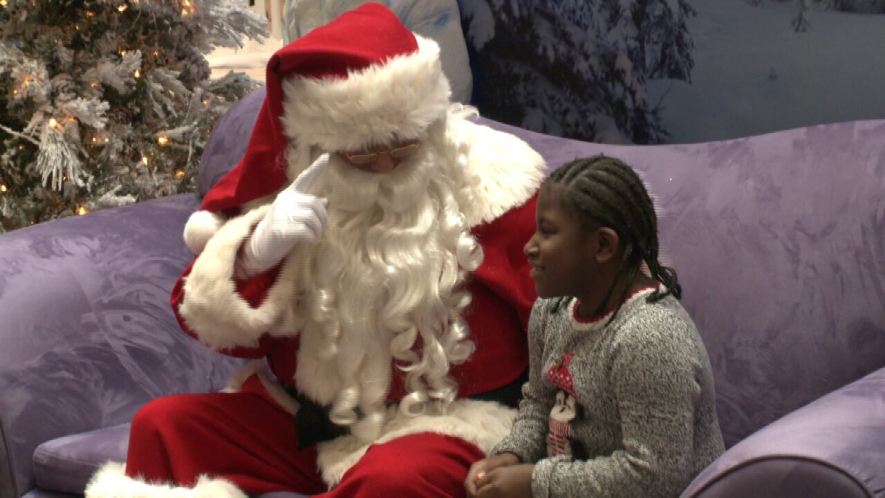 "Children with hearing impairments visit ""Signing Santa"" at MacArthur Center"