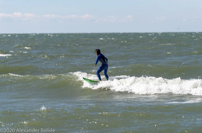 Cat Carrillo catches some waves on Lake Erie.