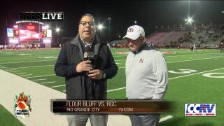 Roland Rodriguez meets with Flour Bluff coach Chris Steinbruck before the Hornets' playoff game tonight at Rio Grande City.