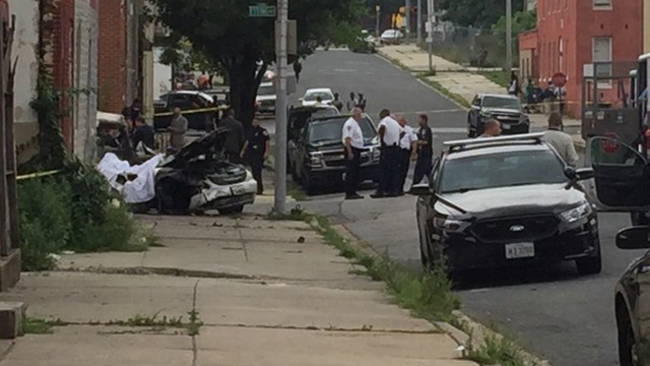 Person killed in car crash in West Baltimore
