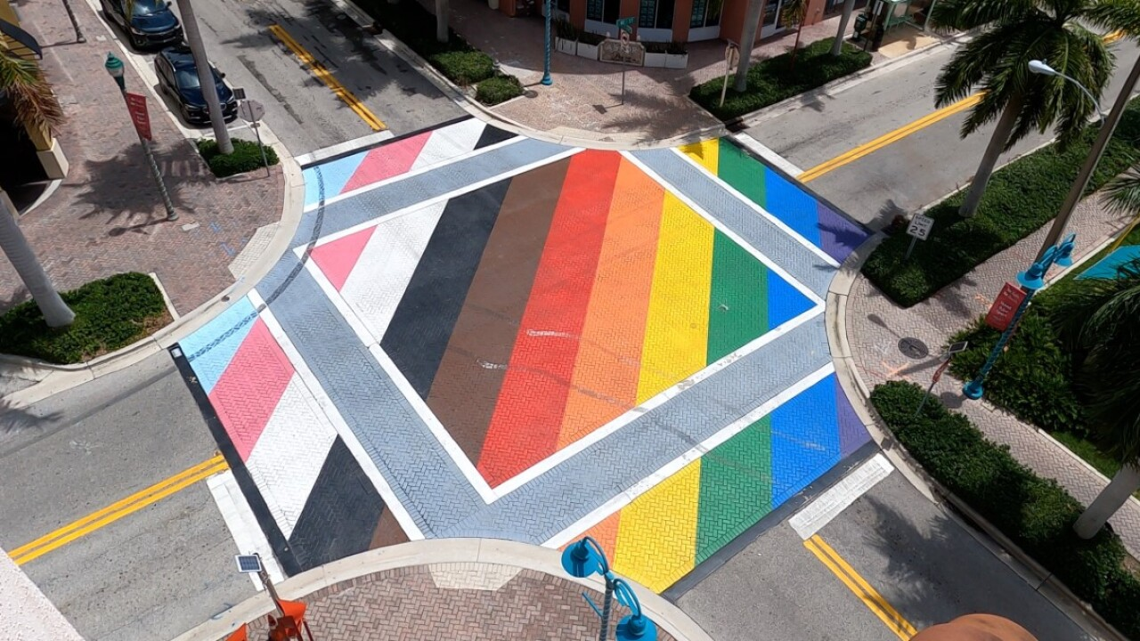 A vandalized LGBTQ Pride intersection and crosswalk at Northeast First Street and Northeast Second Avenue in Delray Beach on June 28, 2021.jpg