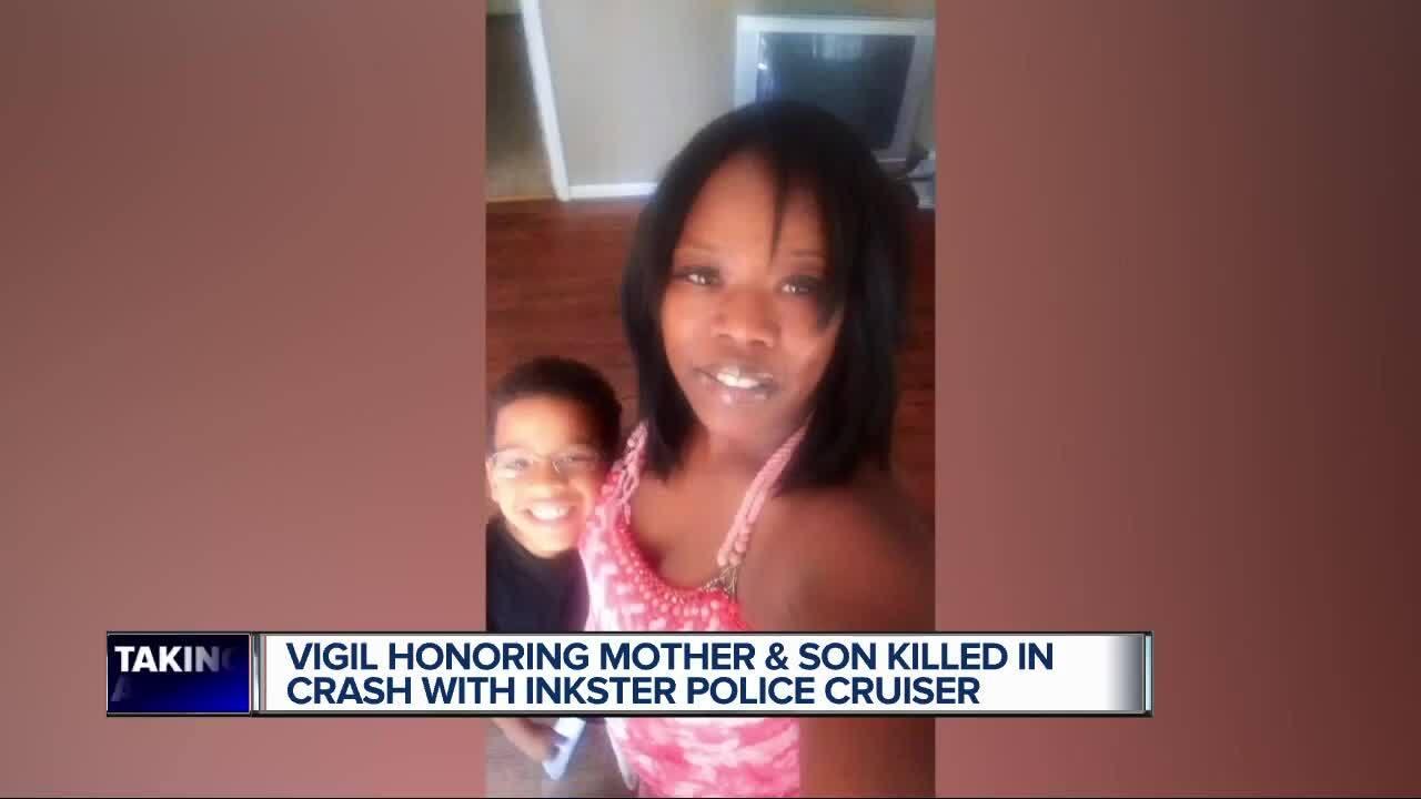 Inkster vigil for mother, son killed in crash.jpg