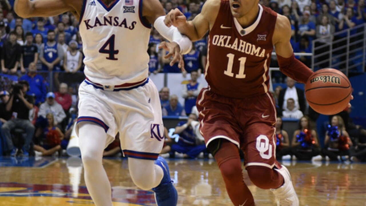 Jayhawks hit century mark in 104-74 win over Oklahoma; KU takes half-game lead in Big 12
