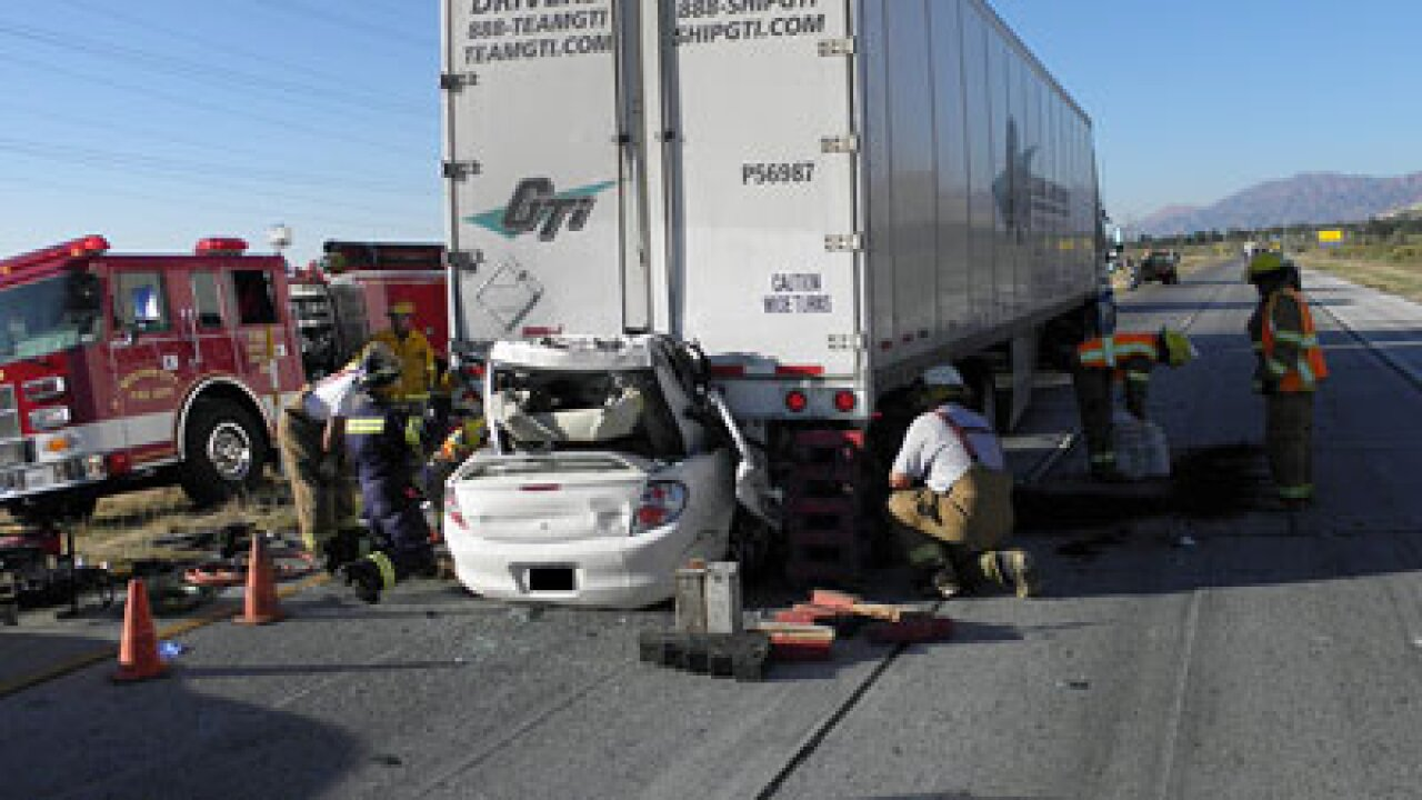 One dead after car crashes into semi on I-15