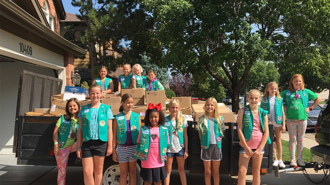 CO Girl Scouts deliver school supplies to needy
