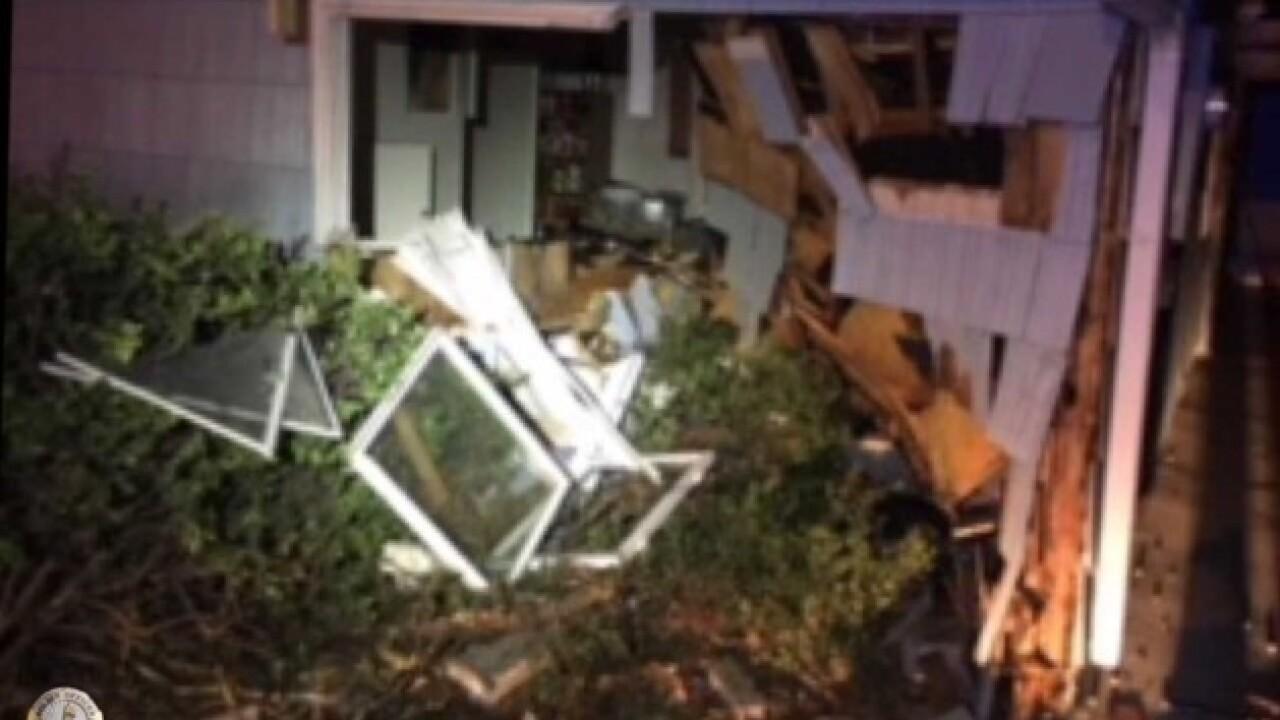 Police investigate car vs. house crash