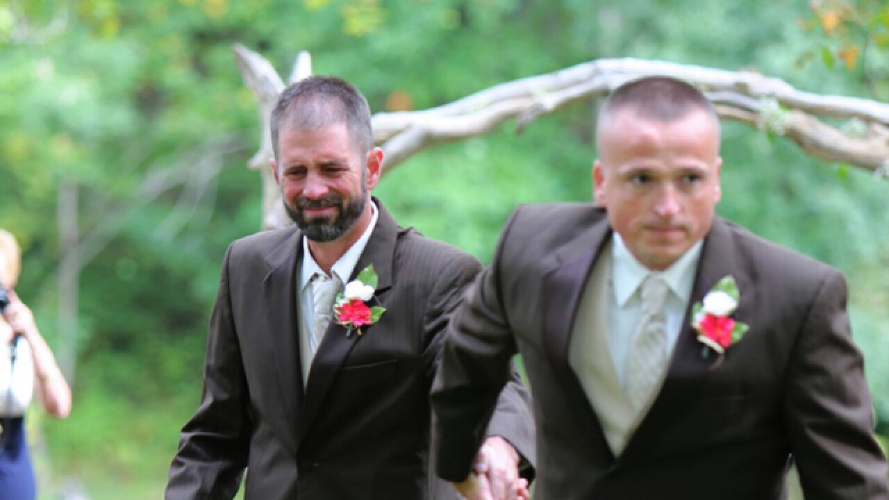 Father has bride's stepdad join walk down aisle
