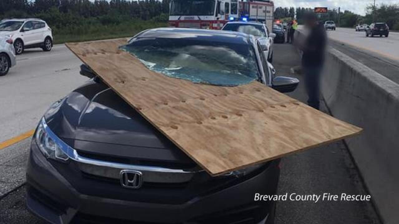 Plywood rams through Florida woman's windshield