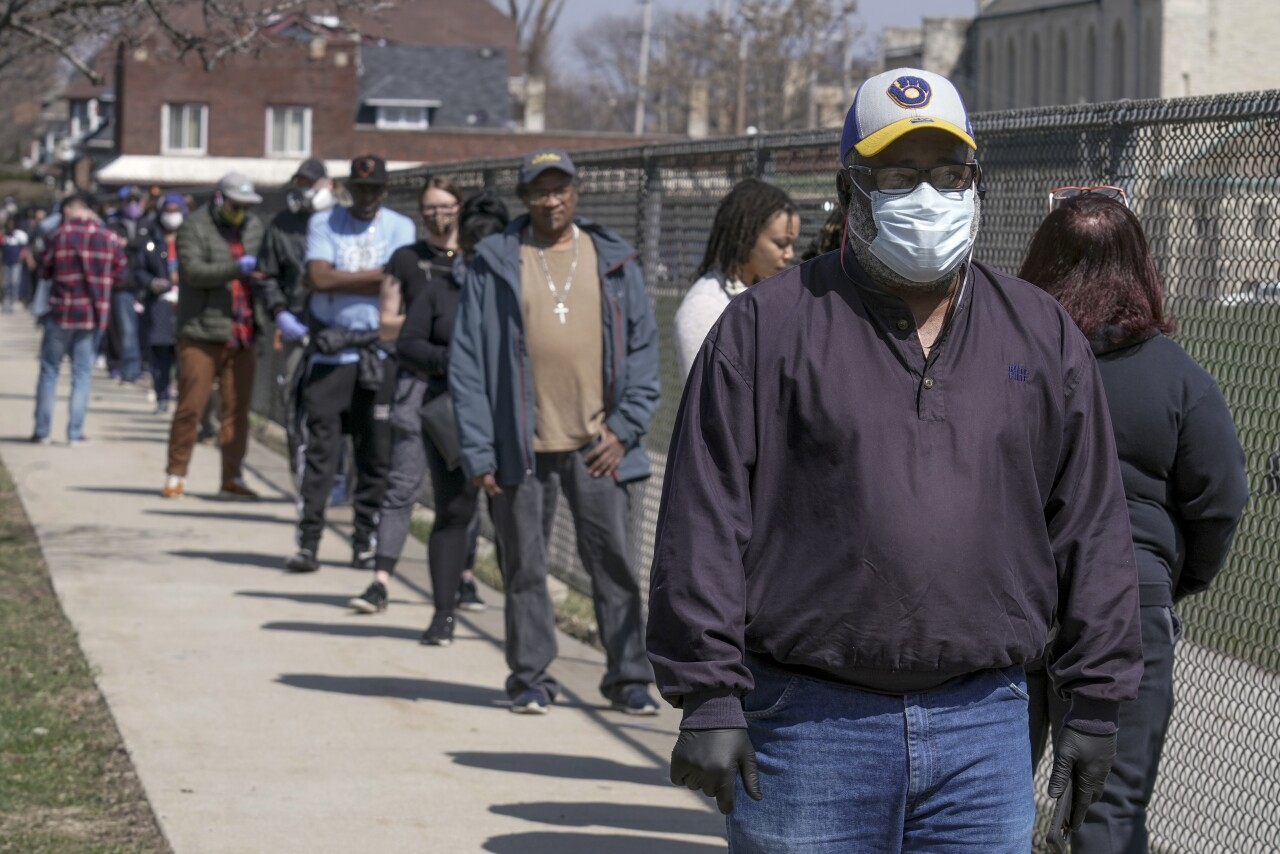 People in Wisconsin line up to vote during coronavirus pandemic