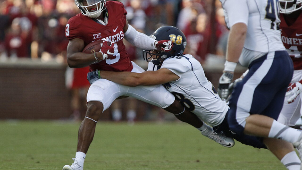 Sooners roll Zips 41-3