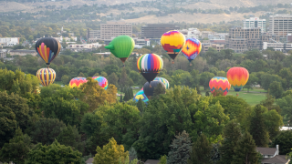 Hot air balloons across Boise skyline