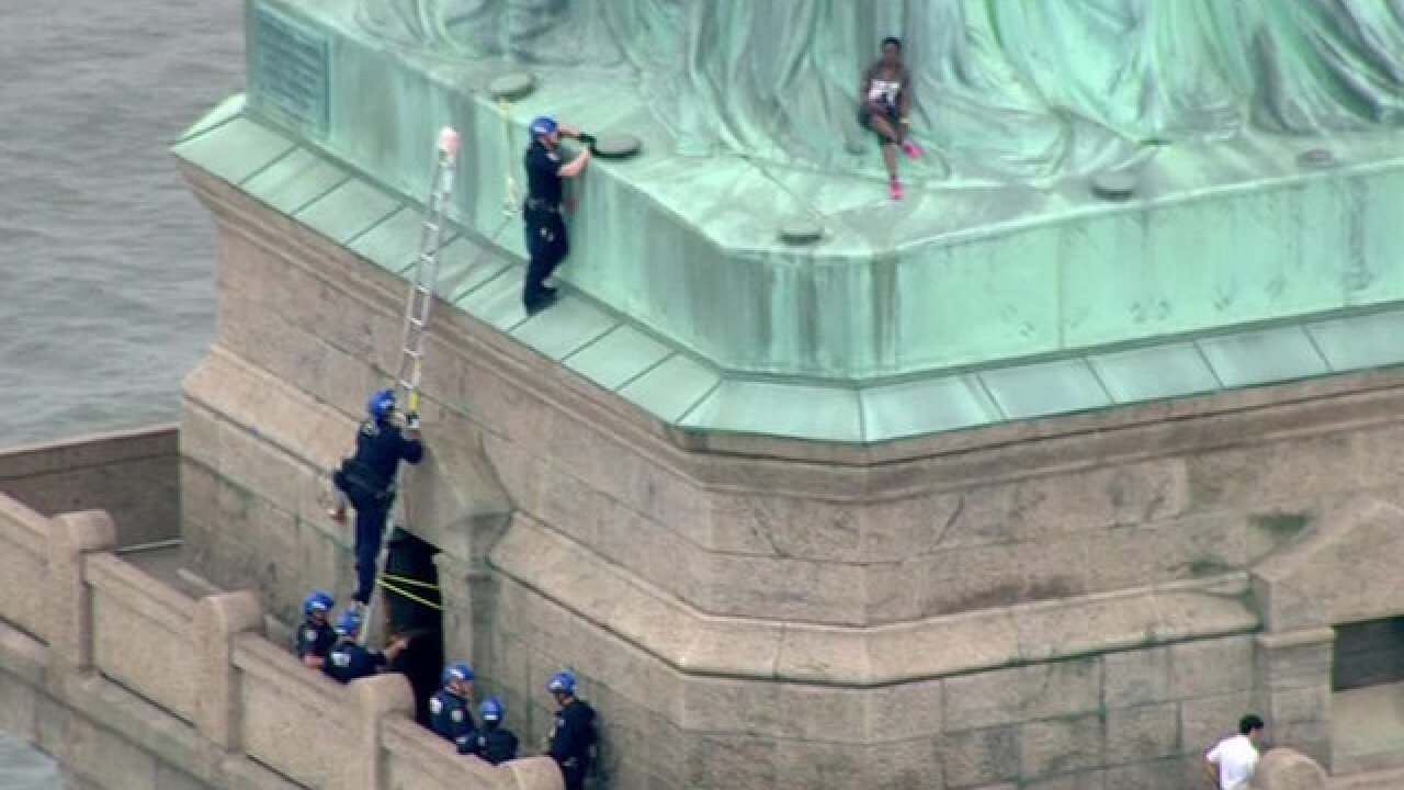 Woman who climbed Statue of Liberty's base is federally charged, faces time in prison