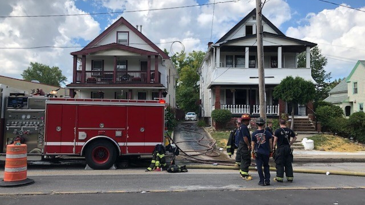 Cleveland firefighters rescue woman from house fire on city's east side