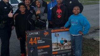Making A Difference: Officers Surprise Kids Playing Basketball With New Hoop