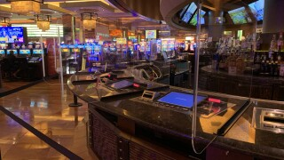These are plastic dividers located at bar tops with gaming machines as seen in Sept. 2020