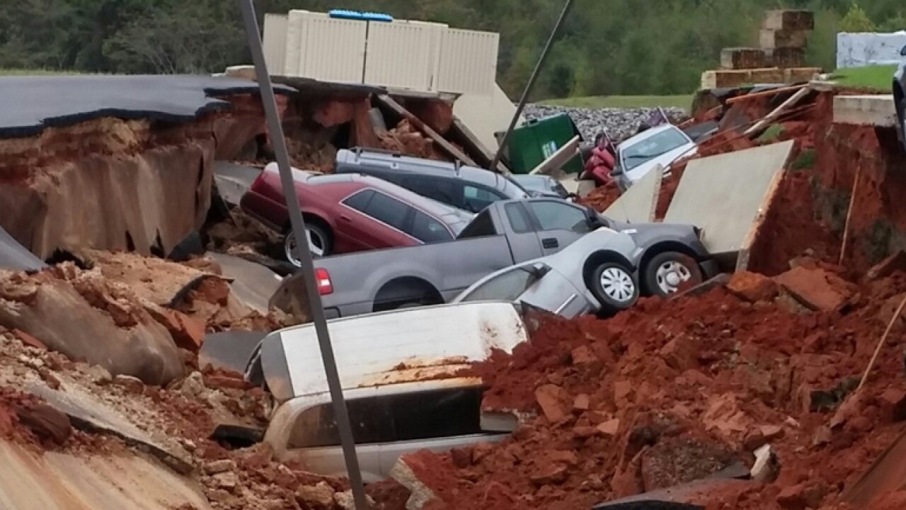 Sinkhole in Mississippi swallows more than a dozen cars