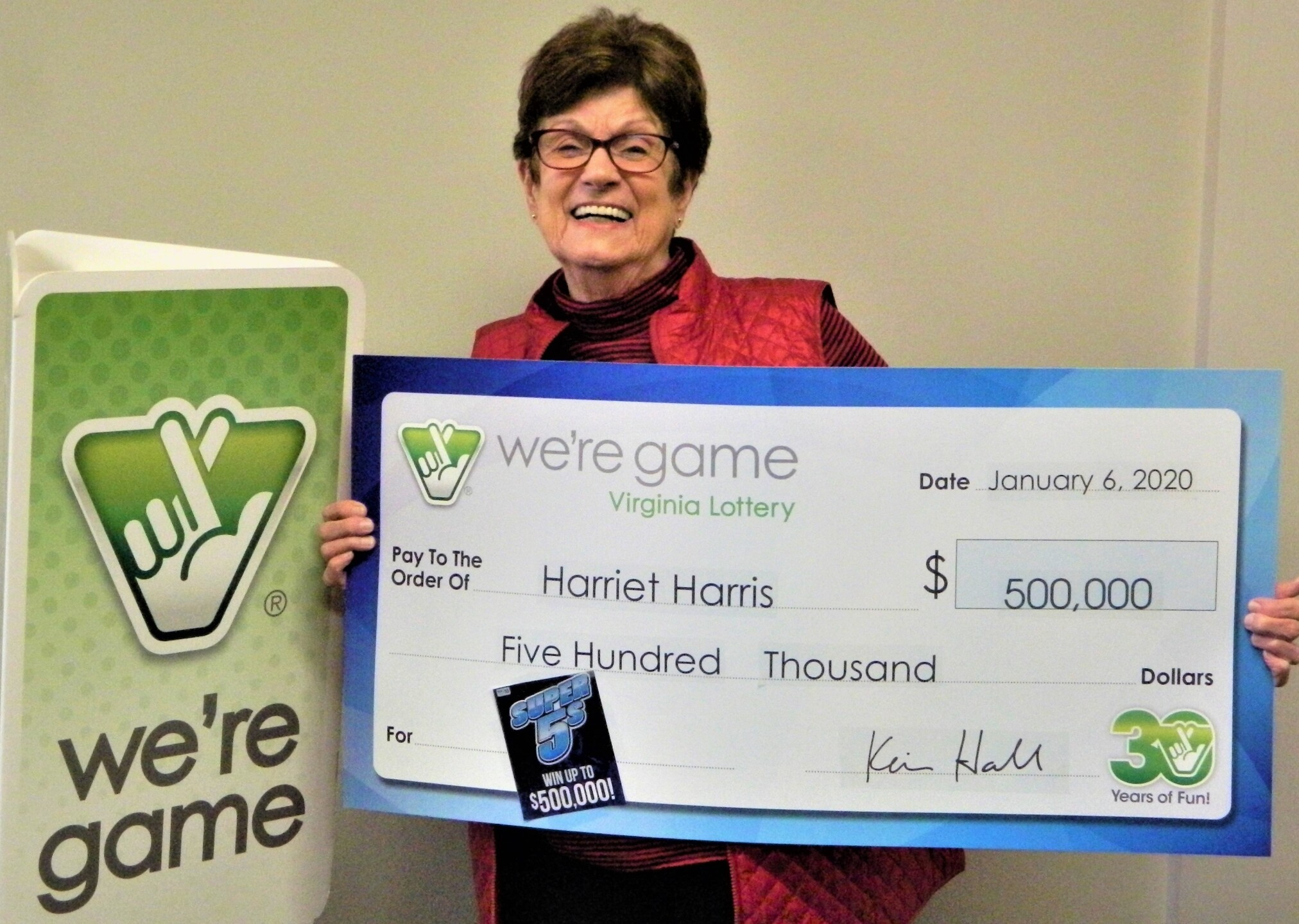 Photos: Williamsburg woman receives $500,000 winning lottery ticket in Christmasstocking