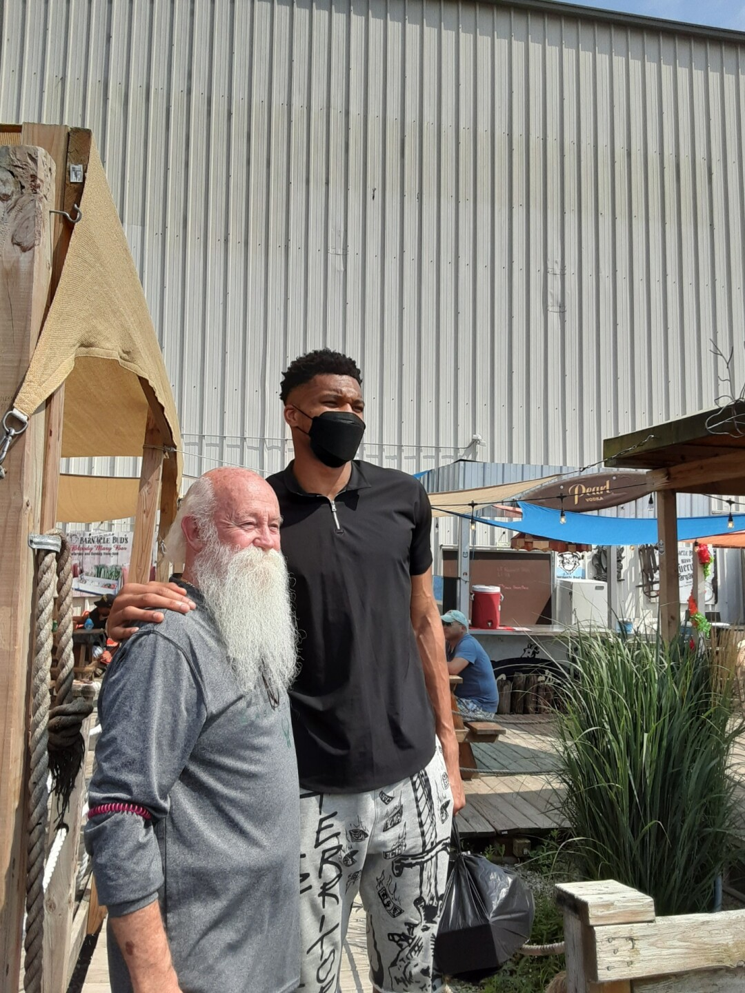 Owner Gene McKiernan and Giannis Antetokounmpo snap a picture after the NBA star leaves Barncle Buds