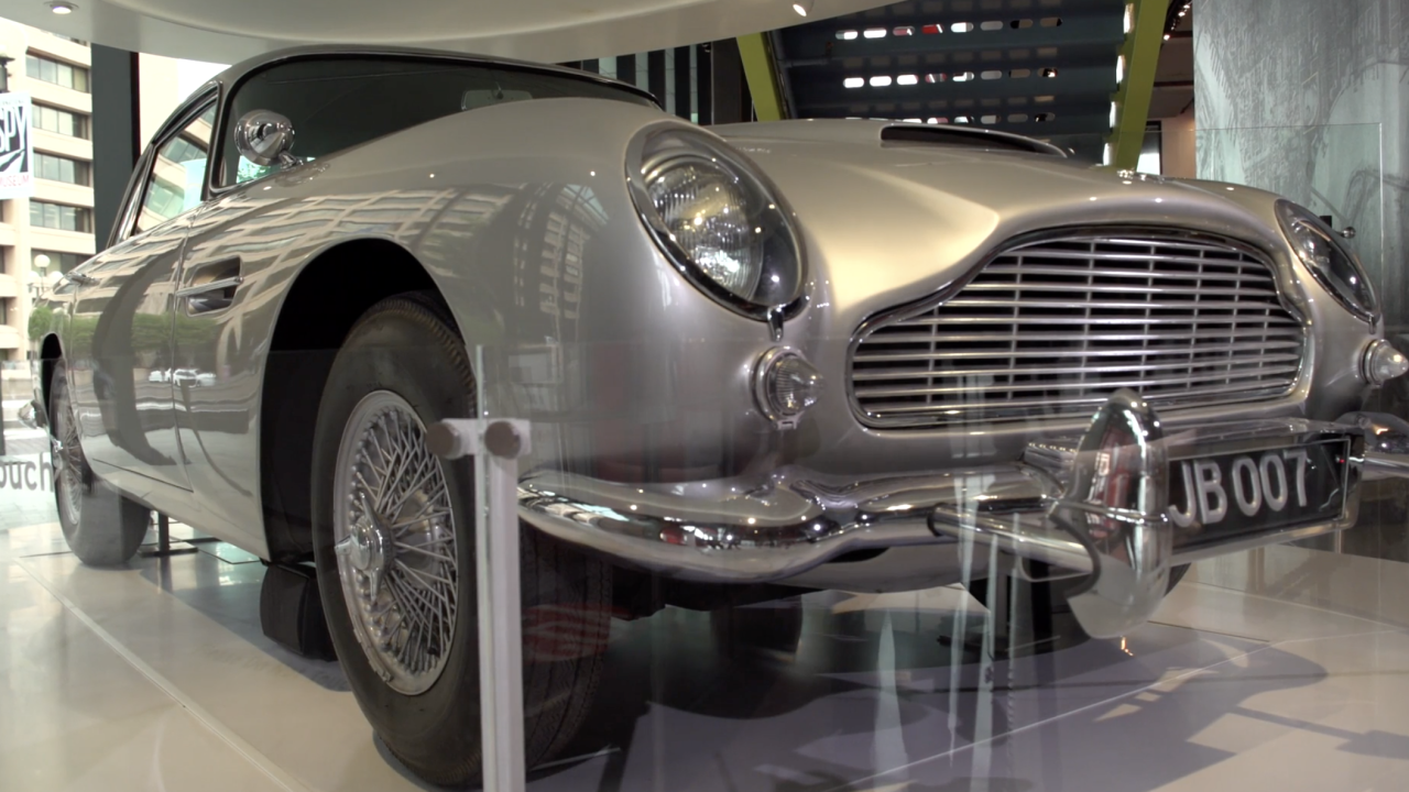 """At the International Spy Museum in Washington, D.C., one of the original cars driven by James Bond in the movie """"Goldfinger"""" is on display. The museum has reopened after COVID-19 forced it to close for part of the last year."""