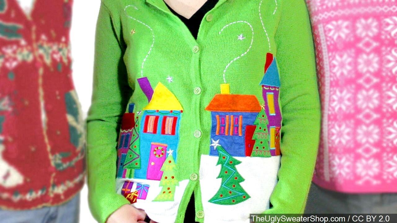 People wearing ugly Christmas sweaters
