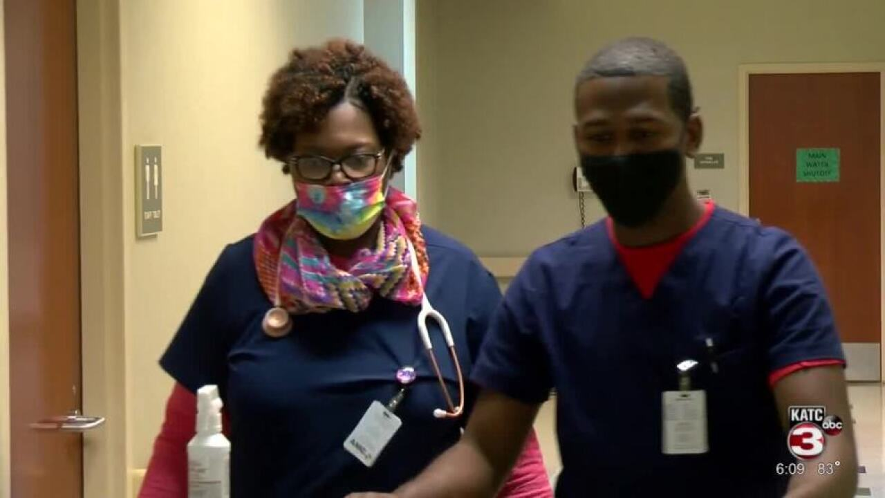 Spirit of Acadiana - Mother and Son Nurses Work Together in local hospital.jpg