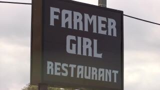 Farmer Girl Restaurant sign closeup