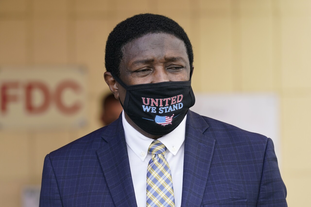 Dale Holness wearing 'United We Stand' mask in 2020