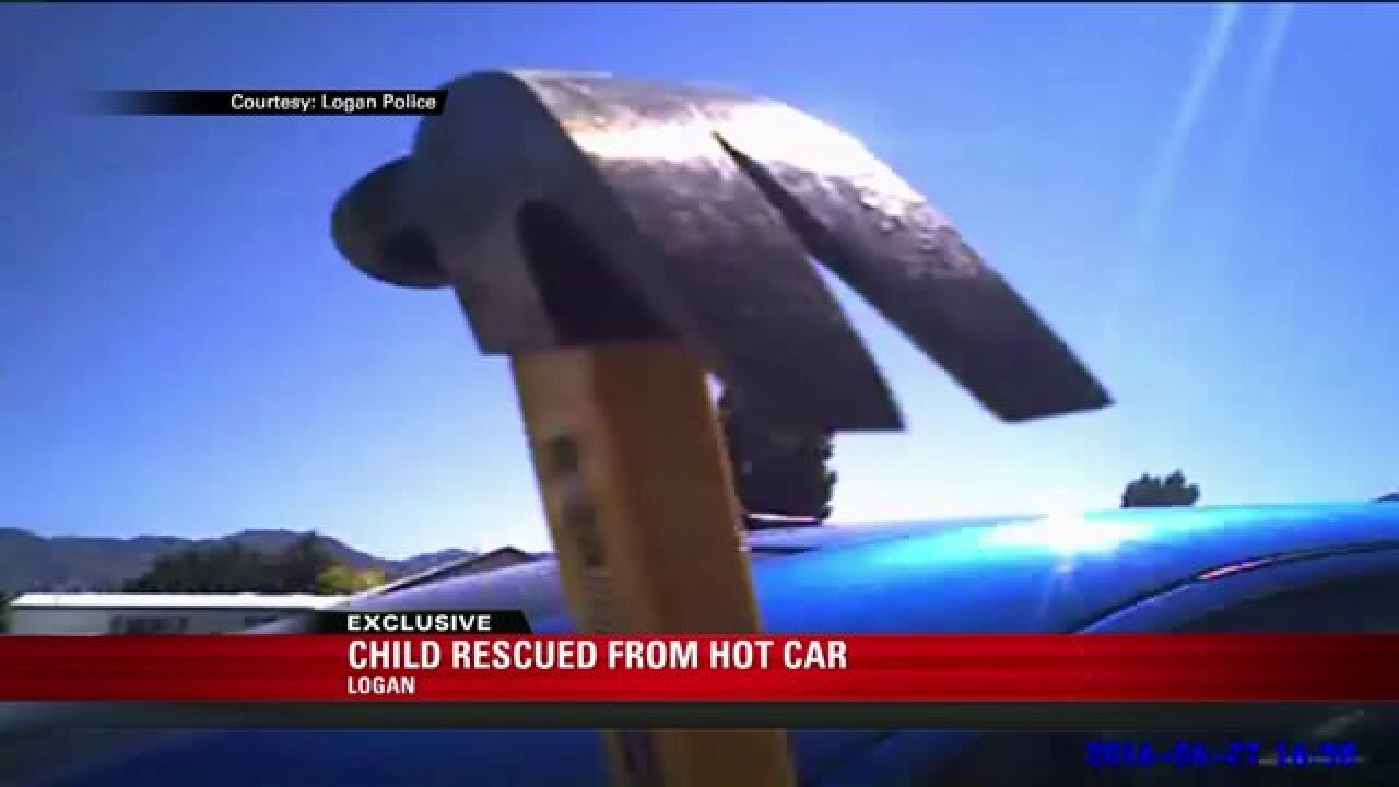 Police video: child rescued from hot car in Logan