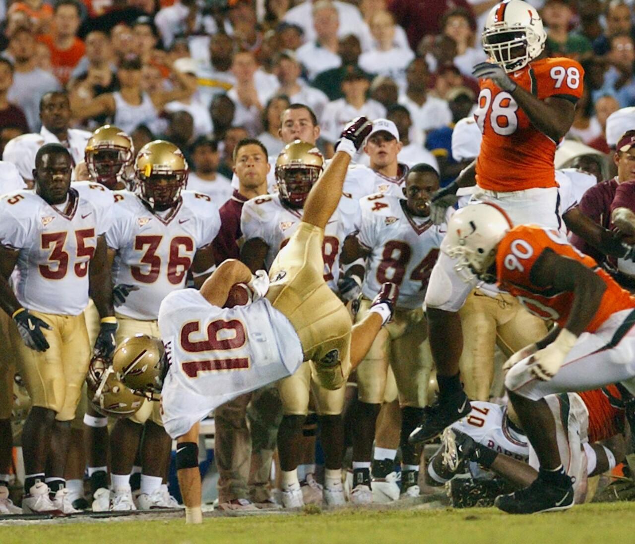 Florida State Seminoles QB Chris Rix leaps for yardage at Miami Hurricanes in 2004