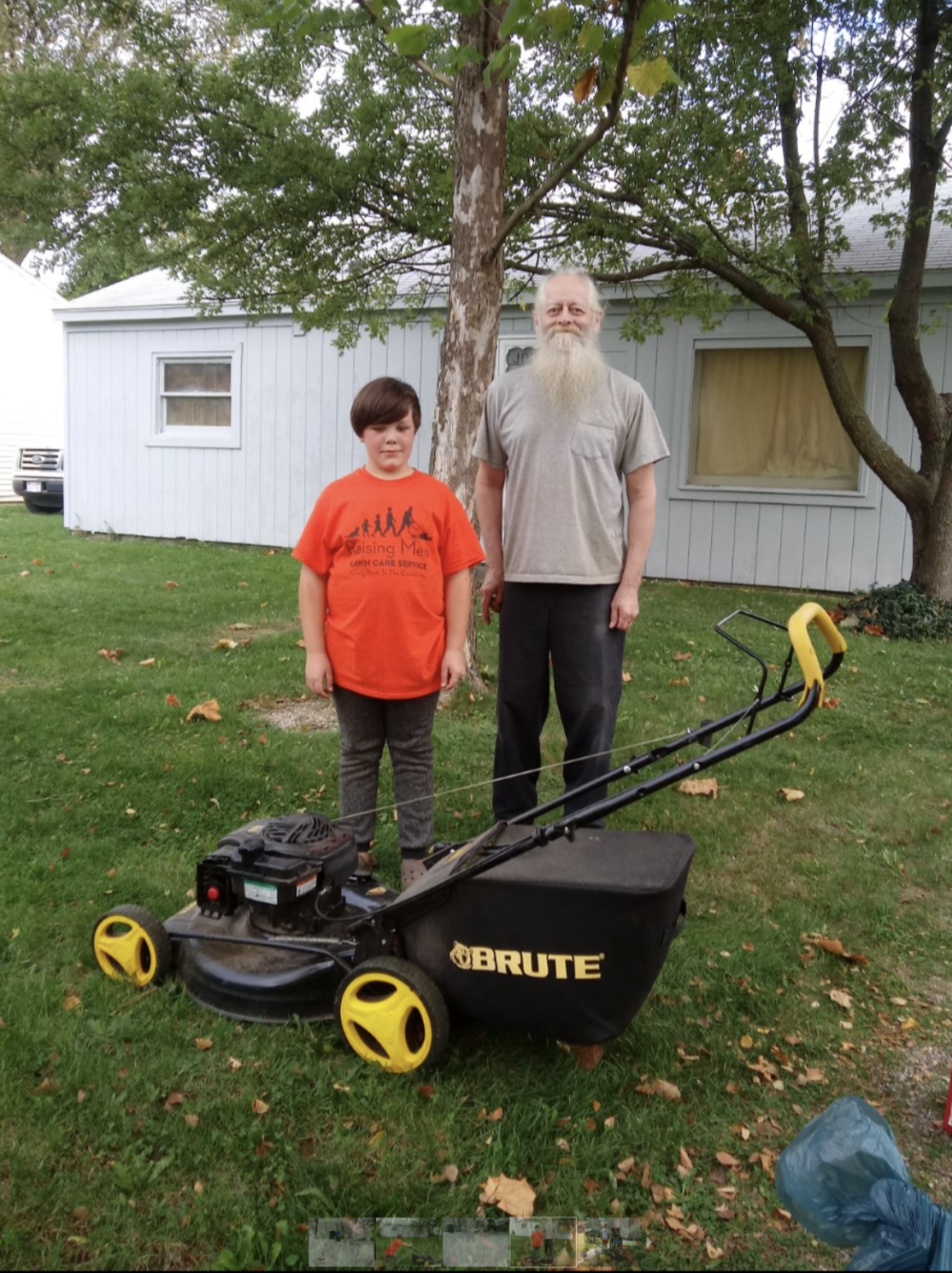 """Patrick McClellan with his lawnmower and one of his """"clients"""""""