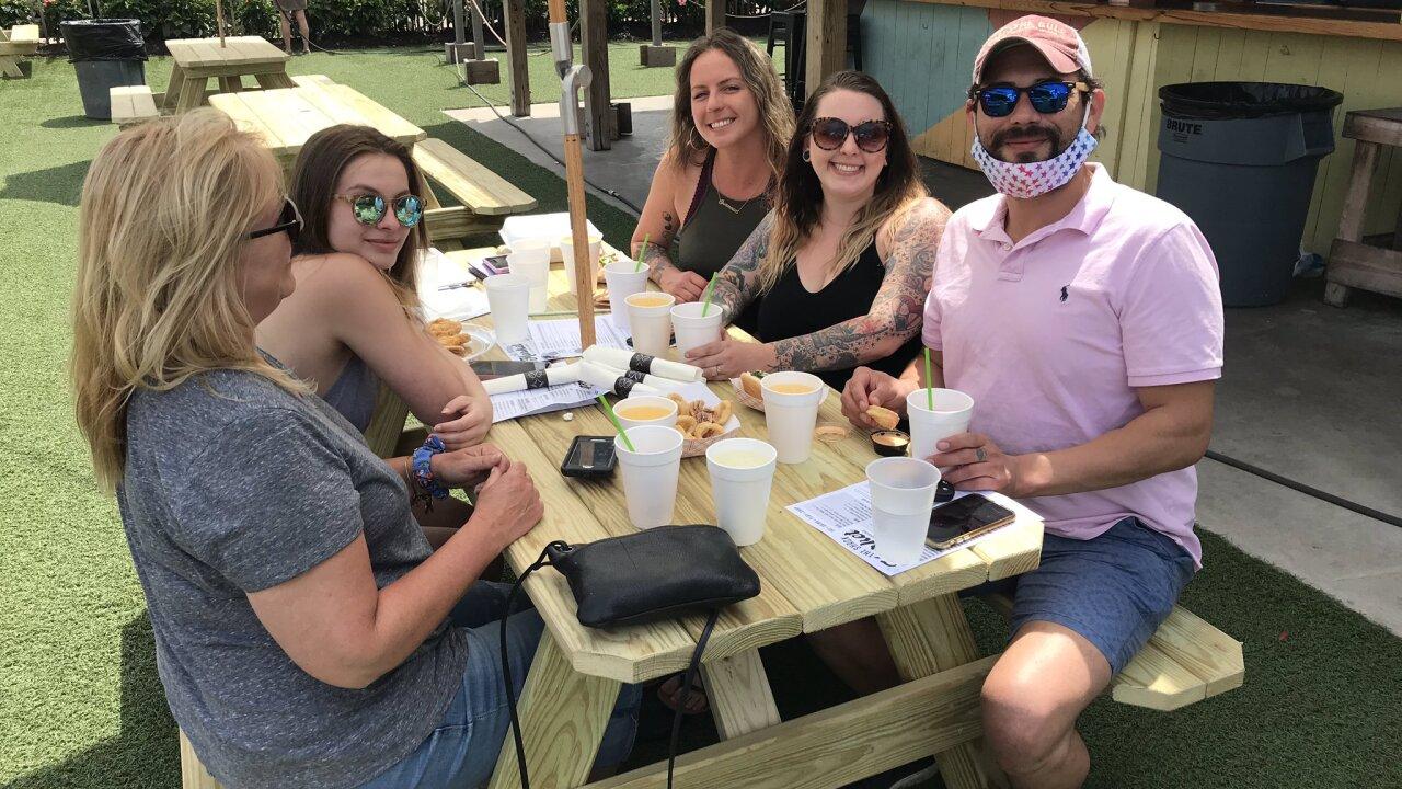 customers social distance at the shack virginia beach