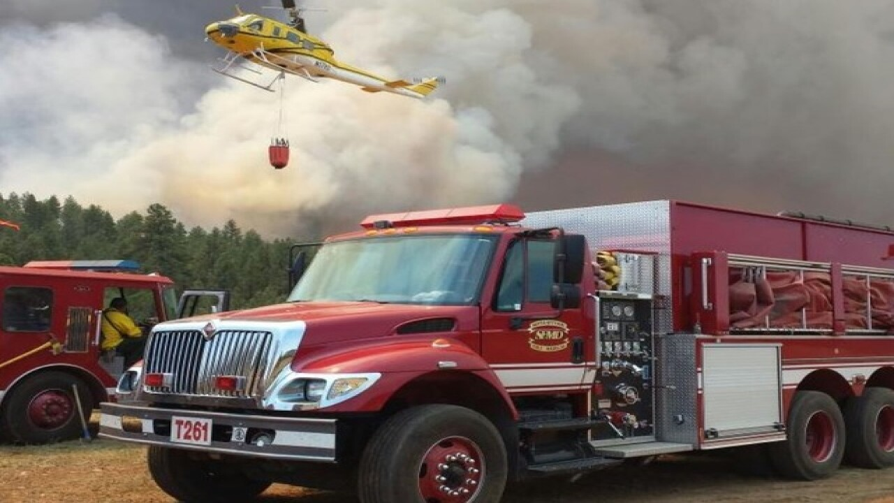 Cedar Fire jumps containment line, heads south