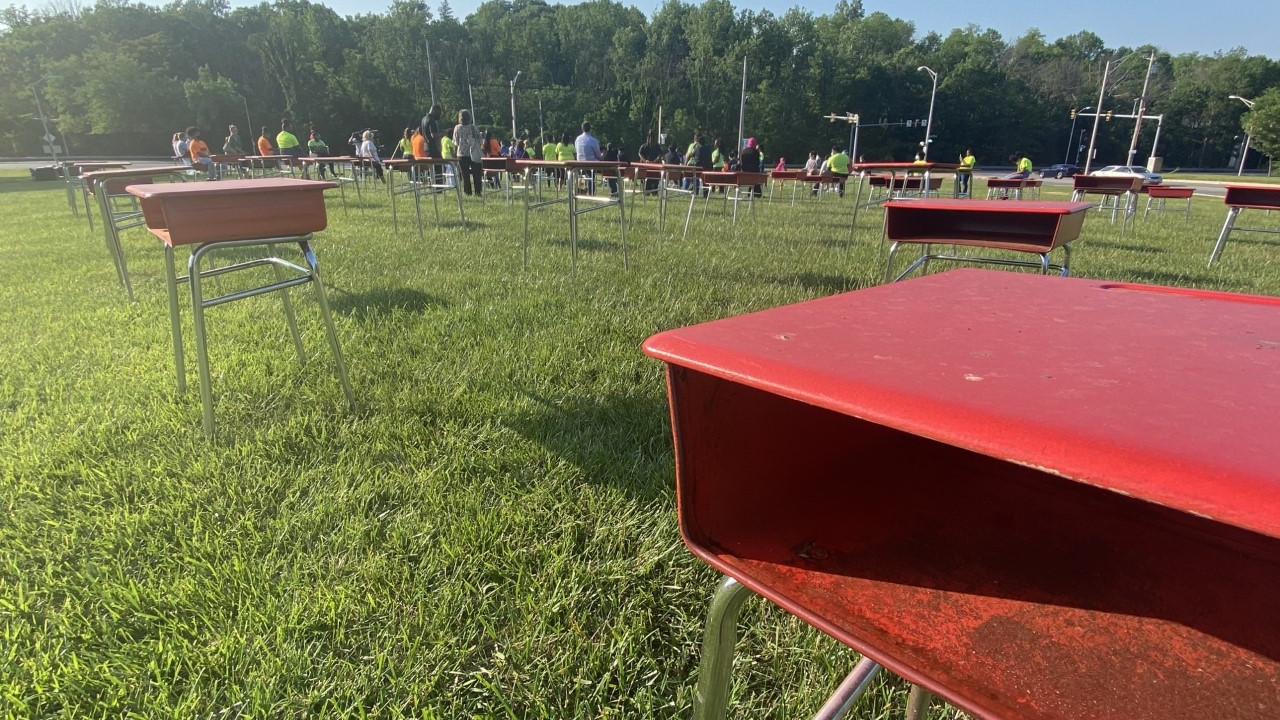 112 red desks for the children who were killed in Baltimore