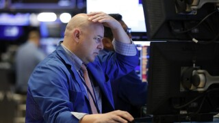 US stocks tumble as investors grow concerned about impact of new coronavirus