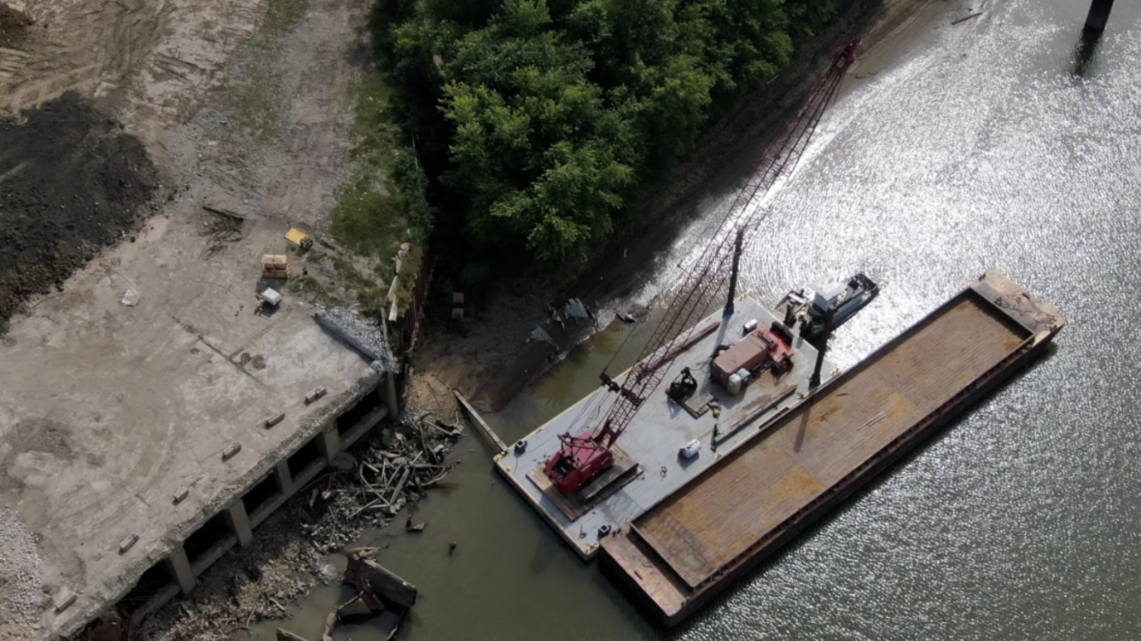 A barge-mounted crane arrived at Beckjord on Sept. 17, 2021 to remove smokestack from Ohio River.