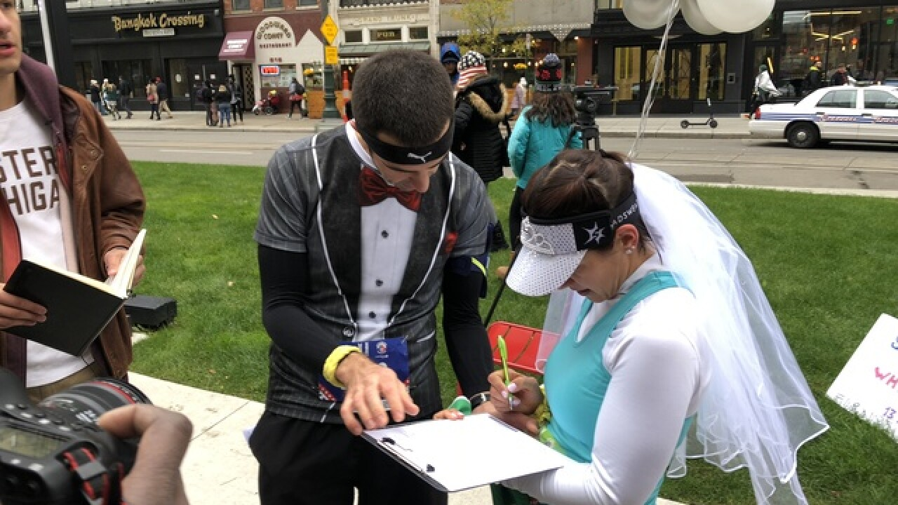 Sole mates: Couple weds halfway through marathon