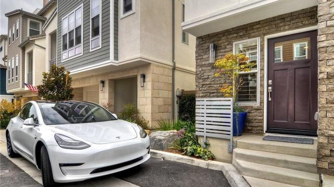 Costa Mesa condo owner throws in Tesla as buyer incentive