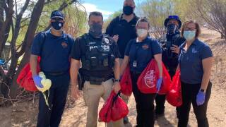 TPD, TFD, TMC hand COVID-19 supply kits to homeless