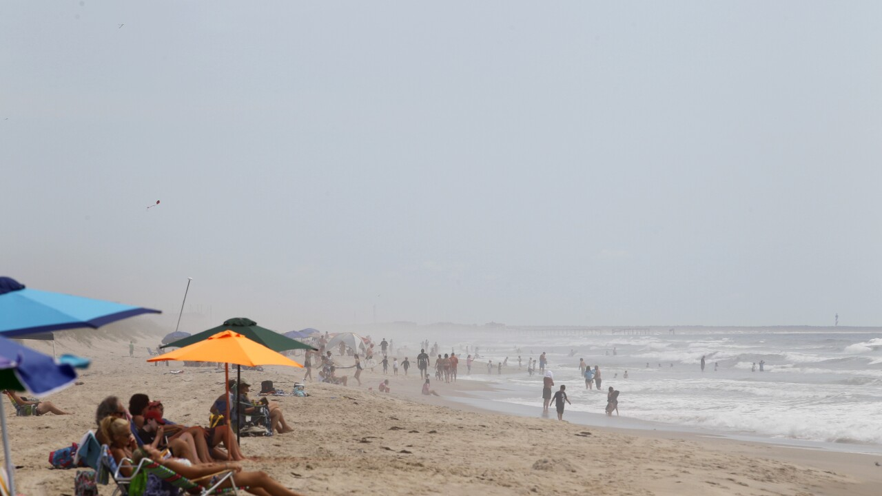 FILE - This Aug. 24, 2011 file photo shows beachgoers at Cape Hatteras. N.C. The Cape Hatteras National Seashore.