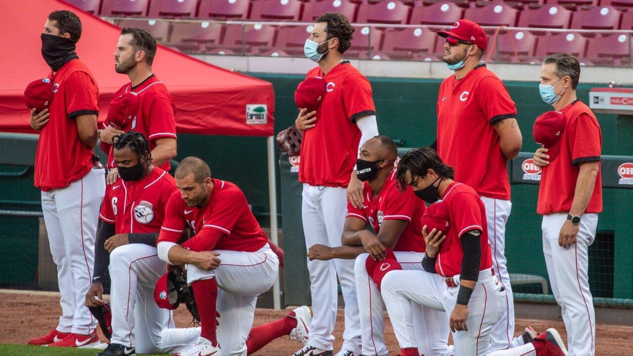 Reds kneel.jpg