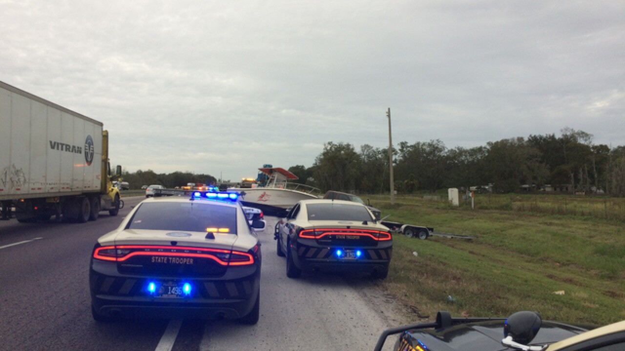 Boat separated from truck, trailer on I-4